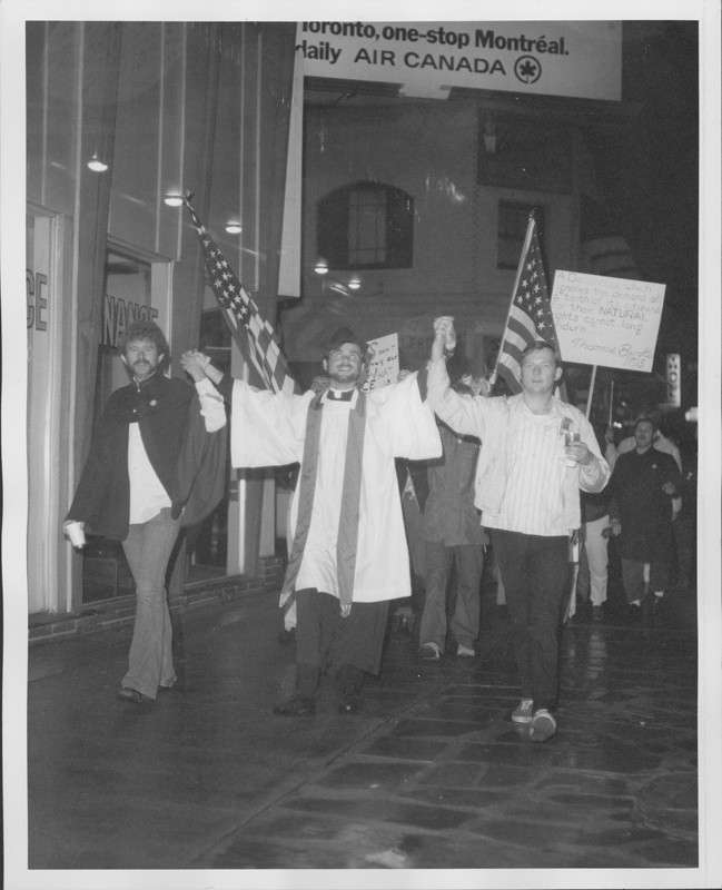 Three members of the Metropolitan Community Church (MCC) lead the Hollywood candlelight march for homosexual law reform. 1970.