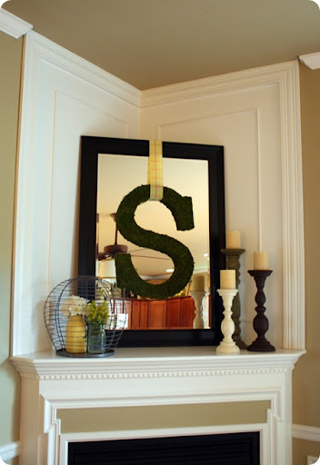 A mirror over the mantel from Thrifty Decor Chick