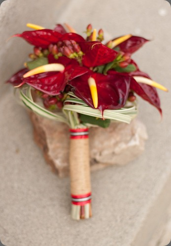 anthirum-bouquet  anthiriums accented with red hypericum berries and variegated lily grass looped jacqueline ahne