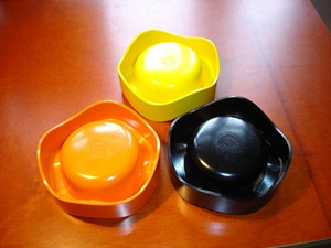 Helit Sinus ashtray yellow, orange, and black imprint