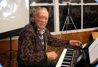 Birthday Boy, Colin Crann, setting-up to play his mini-concert for us on his lovely, new Korg Pa3X. Photo courtesy of Dennis Lyons.