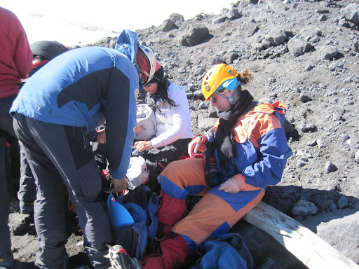 Heather getting help putting on her crampons.