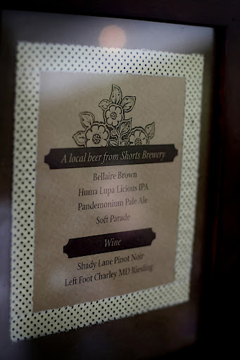 The drink menus were printed on kraft paper and framed with polka-dotted fabric.