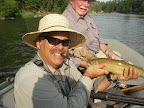 Jack Saunders caught a cuttbow on the Blackfoot river. Jack Mauer is holding the fish.