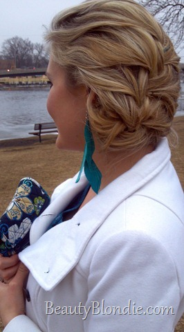 Braided Up-do with Teal Feather Earings, a Vera Purse and White Coat
