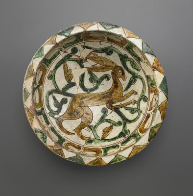 Bowl | Origin:  Iran | Period: 12th-13th century  Saljuq period | Details:  Not Available | Type: Earthenware incised and painted over glaze | Size: H: 8.2  W: 25.1  cm | Museum Code: F1967.4 | Photograph and description taken from Freer and the Sackler (Smithsonian) Museums.