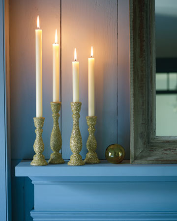 Dress up plain candlesticks by dusting them with glitter. We chose a soft shade of green glitter for these candlesticks.