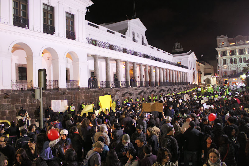 Supporters of Yasuni outside Ecuador's presidential palace.  Pro-drilling government supporters held a counter protest.