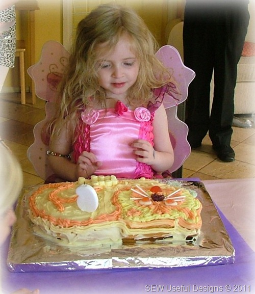 Rosie birthday cake candle blowing pic