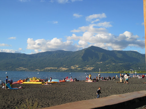 The volcanic black sand beach on Lake Villarrica.