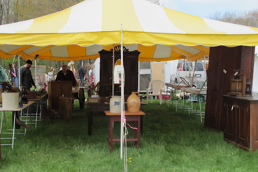 Tents are a necessity to keep antique pieces safe and dry.