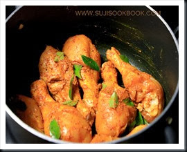 Chicken marinated with spice powders and curry leaves