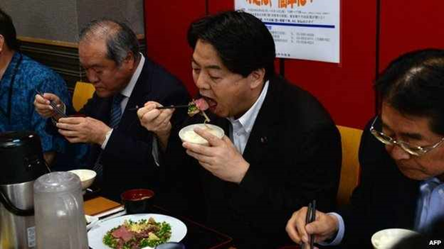 On 9 June 2014, Japanese Agriculture Minister Yoshimasa Hayashi (centre) held an event promoting whale meat. Japan's Prime Minister Shinzo Abe has said Japan will step up efforts to resume its annual whale hunt in the Antarctic. Photo: AFP