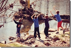 boys-throwing-rocks-in-rive