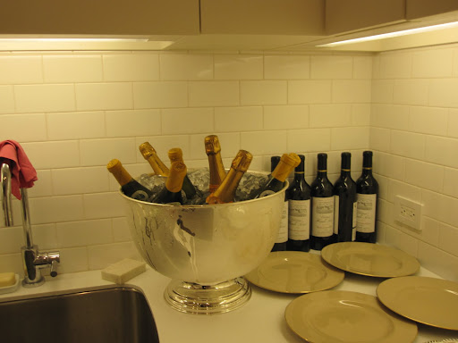 The champagne is chilling in the kitchen.