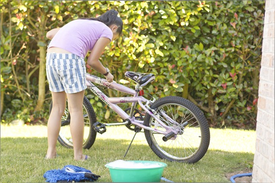 Trina cleaning her bike