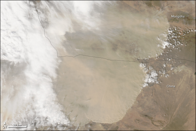A wall of dust was barreling across northern China on 23 April 2014, when the Moderate Resolution Imaging Spectroradiometer (MODIS) acquired this image from NASA's Aqua and Terra satellites. Photo: Jeff Schmaltz / LANCE/EOSDIS MODIS Rapid Response Team at NASA GSFC
