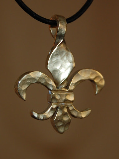 Twisted Brass Fleur de Lis pendant by John Doherty www.twistedfleurdelis.com  http://www.facebook.com/pages/Twisted-Fleur-de-Lis/135050573189242