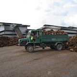 Photo1. An oil mill factory and pile of oil palm fruit.