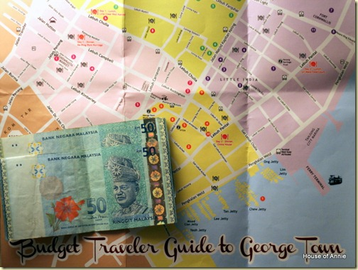 A hundred ringgit and a map of Georgetown, Penang