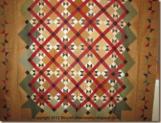 red green quilt with caption