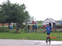 WACO Students and other volunteers help to clean up damage at 1367 111th Street in Henry County