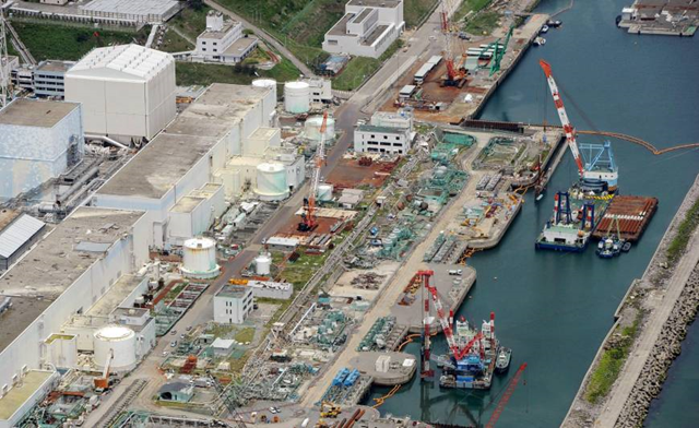 Aerial view of Fukushima nuclear plant. Japan's Nuclear Regulation Authority said on 10 July 2013 it strongly suspects highly radioactive water at the Fukushima No. 1 nuclear plant is seeping into the ground and contaminating the Pacific Ocean. Photo: KYODO