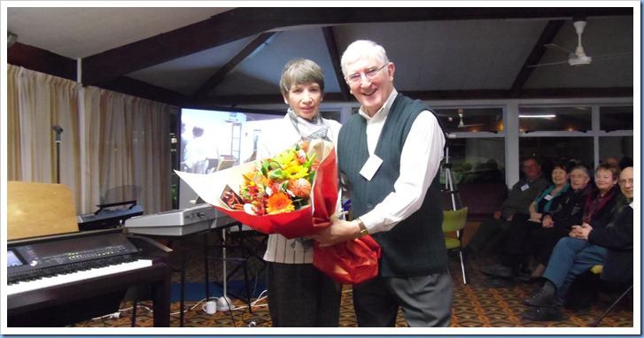 President, Gordon Sutherland, presenting our former Secretary, Colleen Kerr, with a bouquet of flowers as a thank you for being such a great Secretary to the Club for so many years. Photo courtesy of Peter Littlejohn.