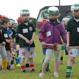 Youngsters wait their turn at hitting sliothars at Camp Ciaran at the Shamocks GAA Club recently (Pic Howard Crowdy)