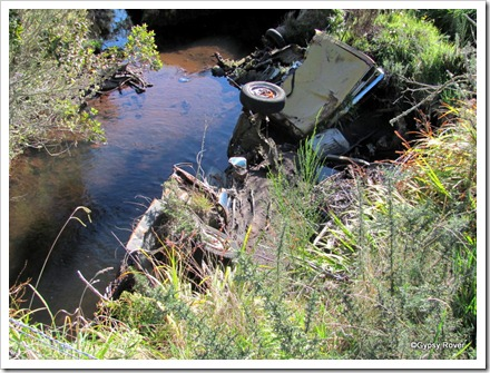 Old dumped cars acting as a stop bank on a river bend. Seddonville has a flooding problem.
