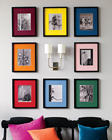 Create a rainbow of colorful mats is a prime example to bring a bit of zip to a collection of black-and-white images. Try old family photographs or convert color ones to black-and-white, and then unify the group with slender, gallery-style black frames.  (marthastewart.com)