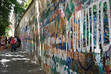 The Lennon Wall - when John Lennon died, this wall became covered with graffiti celebrating his life. Day after day the communist police would paint it over, but each night it would be covered with graffiti again.