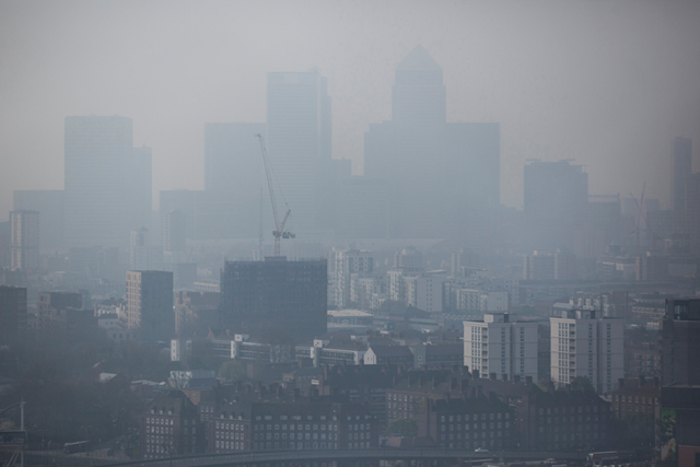 A general view through smog of the Canary Wharf financial district on 2 April 2014 in London. Photo: Dan Kitwood / Getty Images