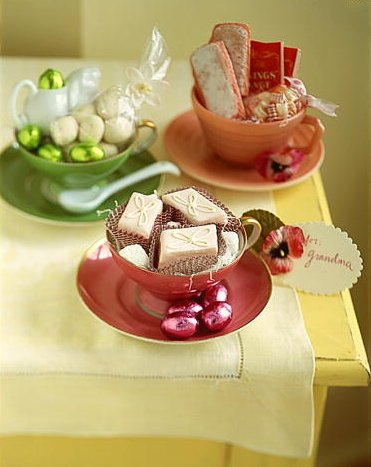 The use of coffee or tea cups as baskets is a wonderful idea. (marthastewart.com)