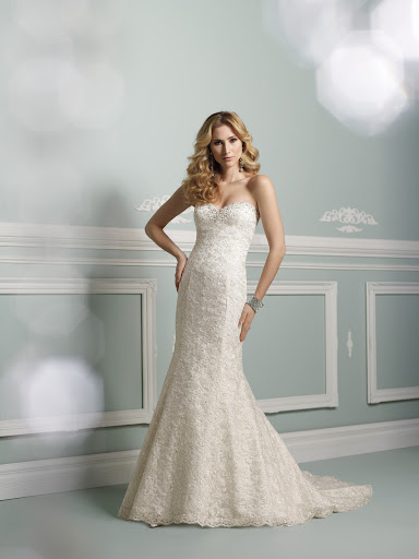 I am loving this romantic strapless gown by James Clifford.