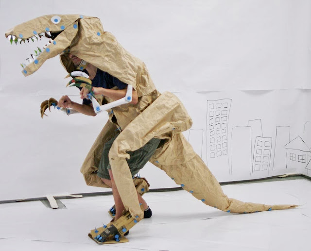 Cardboard dinosaur can walk around.