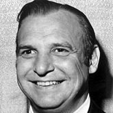 circa 1965:  Headshot of American actor Jackie Coogan (1914-1984) smiling and wearing a tuxedo.  (Photo by Hulton Archive/Getty Images)