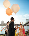 This couple's handmade huppa consisted of fabric garlands held at the center by three extra-large balloons.
