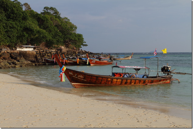 Boats moored at one end of Long Beach, Ko Phi Phi