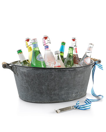 For large bottles or big crowds, you'll need a rustic and spacious ice bucket like this one. Attaching a bottle opener with a ribbon is a great idea as well.  (marthastewart.com)