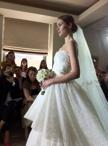 I loved this eyelet tiered strapless gown in ivory organza with a taffeta ribbon.
