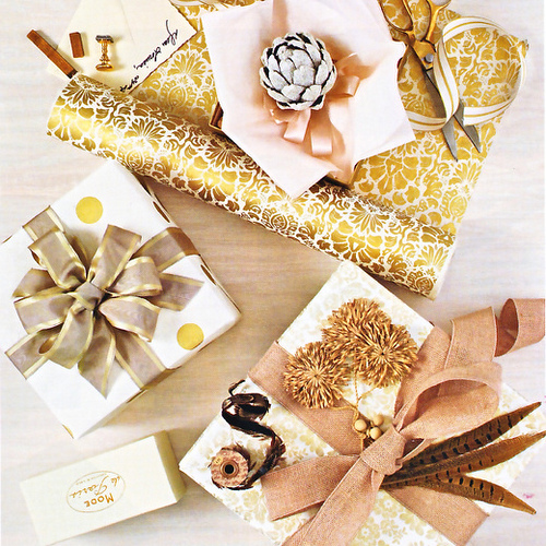 These gifts are wrapped so beautifully and I especially like the feathers. (cocoandkelley.blogspot.com)