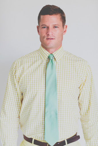 Combine a yellow gingham shirt with a mint tie to get a summer-ready look.