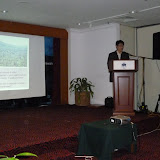 写真3 セミナーで発表するJason Hon氏 / Photo3 Our project member Jason Hon made his presentation at the seminar