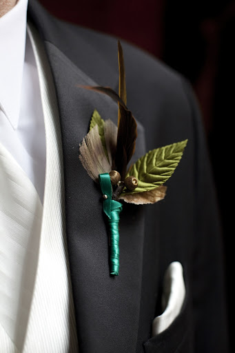 Jamie wore a feather boutonniere.