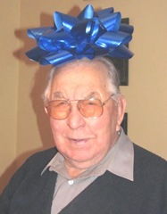 12.25.2011 dad with bow on his head1