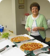 Janice Yuly serves pizza