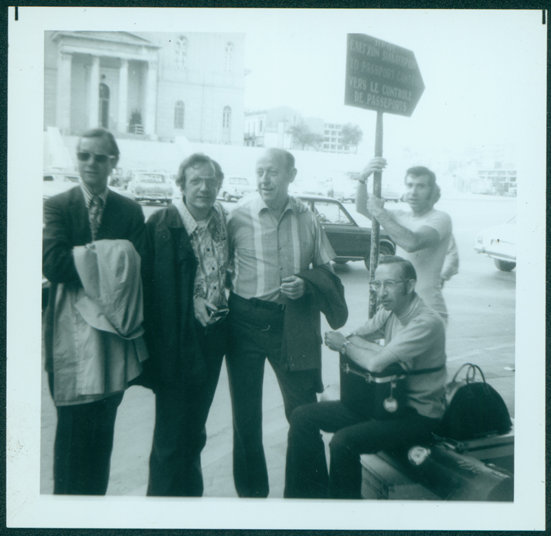 Pat Rocco filmed the 1972 ONE European tour and released the film as ONE Adventure. Along for the tour are W. Dorr Legg (middle), Dick Winters (sitting), and Pat Rocco (holding sign). Legg helped lead the first gay tours starting in 1964 through the ONE Travel Club at ONE Incorporated. 1972.