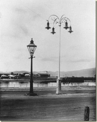 View of an old gas light alongside an electric street light in Townsville June 1922