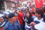 Makabayan's Liza Maza, Bayan Muna's Teddy Casino, and Karapatan's Tinay Palabay negotiate with the police.(Photo by Anne Marxze Umil)